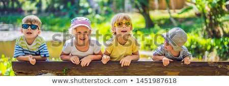 Children rest during a hike in the woods BANNER, LONG FORMAT Stock photo © galitskaya