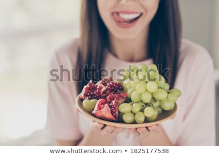 Cropped image of young seductive woman licking her lips Stock photo © deandrobot