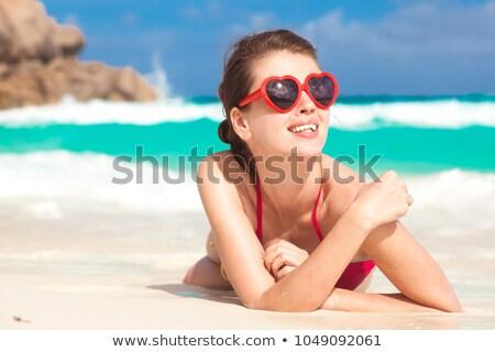 Menina feliz coração óculos de sol praia infância Foto stock © dolgachov