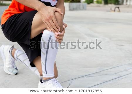 Ferido homem em dor piso de madeira Foto stock © AndreyPopov