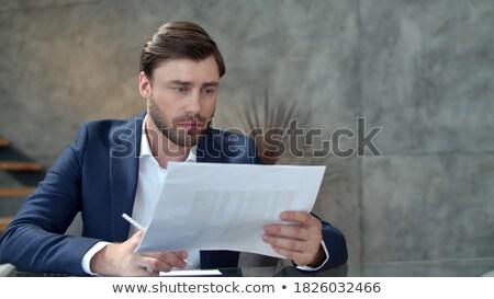 Imagen guapo centrado empresario notas Foto stock © deandrobot