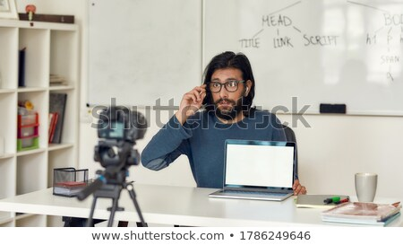 male video blogger adjusting camera at home office Stock photo © dolgachov