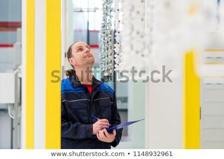 Herstellung Arbeitnehmer Manager Qualität Prüfung Arbeit Stock foto © Kzenon