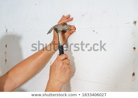 Worker hitting a wall with a sledgehammer Stock photo © photography33