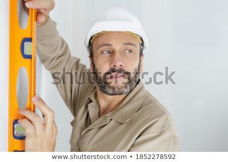 Tradesman holding a spirit level Stock photo © photography33