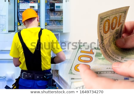Electrician with a handful of cash stock photo © photography33