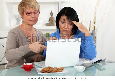 Older women puzzling over a laptop Stock photo © photography33
