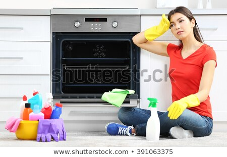 Tired woman cleaning the oven Stock photo © wavebreak_media