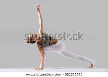 Jonge vrouw revolver geïsoleerd witte gezicht schoonheid Stockfoto © acidgrey