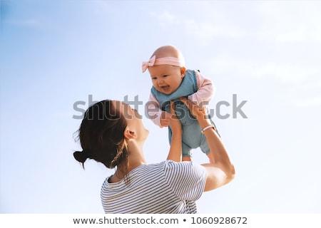 Bebek anne plaj gülen mutlu mavi Stok fotoğraf © luckyraccoon