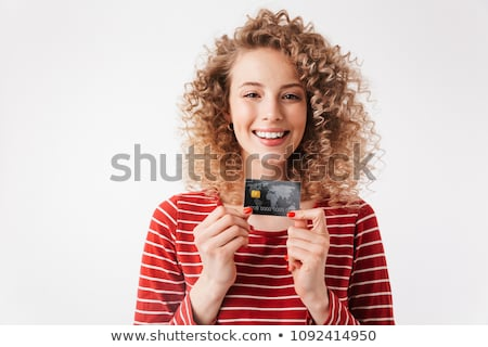 Young woman holding up a credit card Stock photo © stockyimages