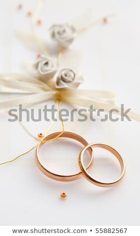 Rojo tejido anillos de boda elegante oro Foto stock © taden