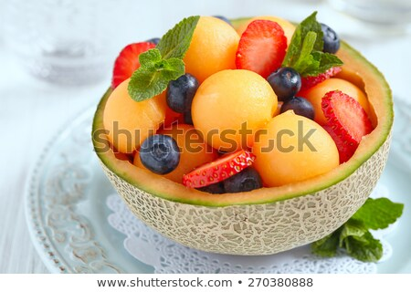 fruit salad in melon bowl Stock photo © M-studio