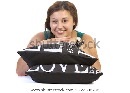 teenage girl laying over pillow on white background Stock photo © manaemedia