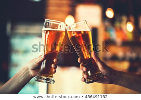 two glasses of beer close-up with froth Stock photo © ozaiachin