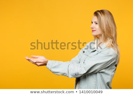 Beautiful confident young woman holding her hair by hands Stock photo © deandrobot