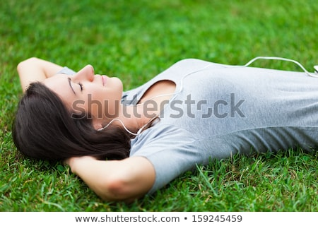 woman relaxing at the park stock photo © stokkete