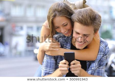 guy and the girl having fun on a city street Stock photo © tekso