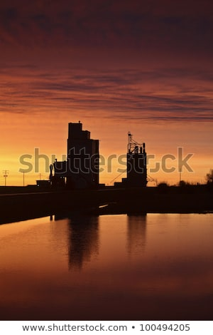 eyebrow gain elevators reflected off water after sunset stock photo © pictureguy