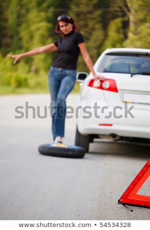 Woman trying to catch someone who may help her Stock photo © Nobilior