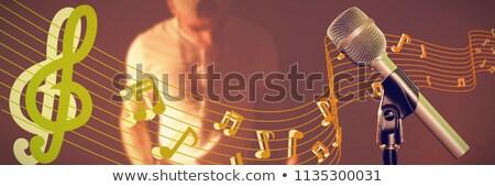 Mikrofon mężczyzna muzyk gry fortepian Zdjęcia stock © wavebreak_media