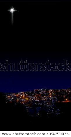 The glow of the Christmas star over the village Stock photo © liolle