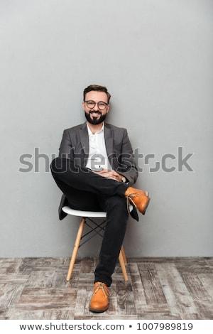 Biznesmen posiedzenia uśmiechnięty działalności człowiek Zdjęcia stock © monkey_business