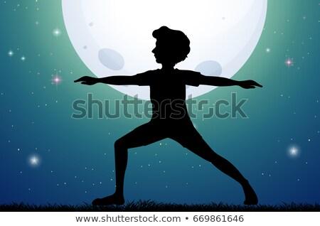 Silhouette man doing yoga on fullmoon night Stock photo © colematt