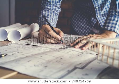 üzletember · álmos · építészeti · tervek · asztal · üzlet - stock fotó © vladacanon