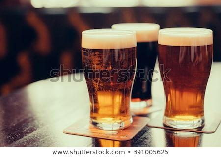 close up of dark draft beer glass mug Stock photo © dolgachov