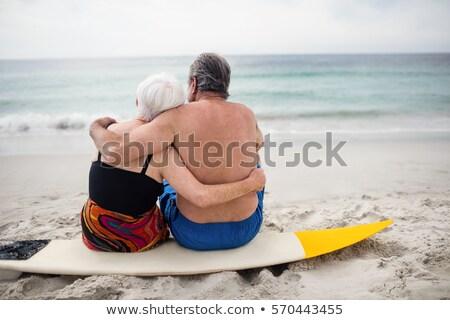 Hátsó nézet idős pár ül szörfdeszka tengerpart napsütés Stock fotó © wavebreak_media