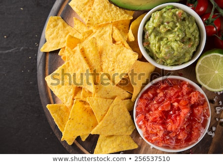 Foto stock: Guacamole Tomato Sauce Salsa And Chips Nachos