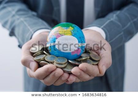 świat świecie maska euro monet biznesmen Zdjęcia stock © nito