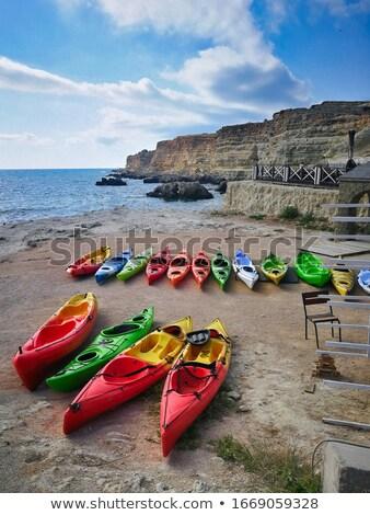 Kayaks lie on the shore near the sea without people Stock photo © ElenaBatkova