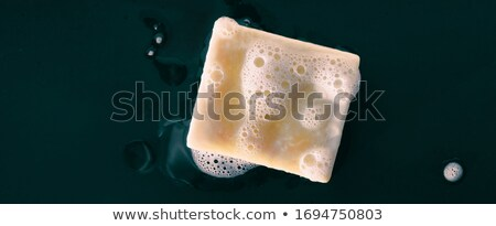 Handmade natural olive oil soap bars DIY homemade soap with lavender essentail oils - activity for w Stock photo © Maridav