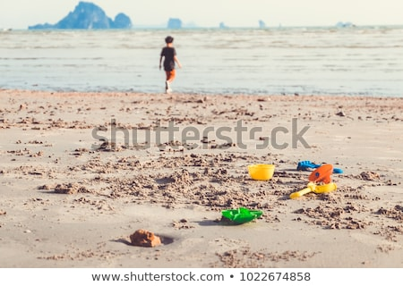 child group have fun and play with beach toys Stock photo © dotshock