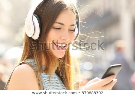 bela · mulher · ouvir · música · branco · música · sorrir - foto stock © Rob_Stark