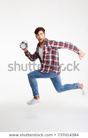 Shocked man with alarm clock Stock photo © photography33