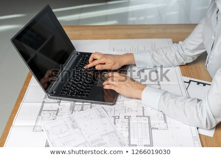 female architect writing on her paper stock photo © zurijeta