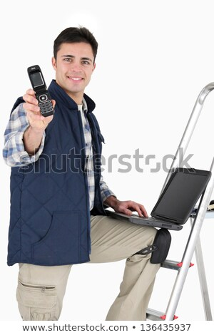happy tiler showing mobile phone Stock photo © photography33
