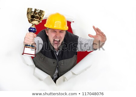 young craftsman holds trophy shouting for joy Stock photo © photography33
