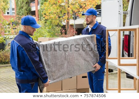 Mover two man loading furniture on truck Stock photo © CandyboxPhoto