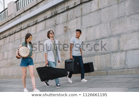 Young man carrying a djembe Stock photo © photography33