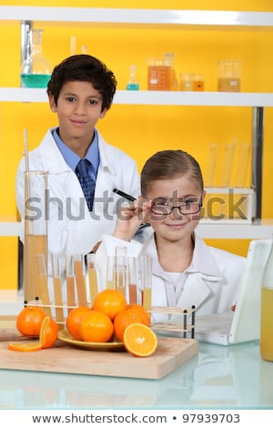 children doing chemistry experiments with orange juice stock photo © photography33