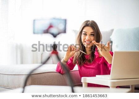 Young woman making gestures  stock photo © ra2studio