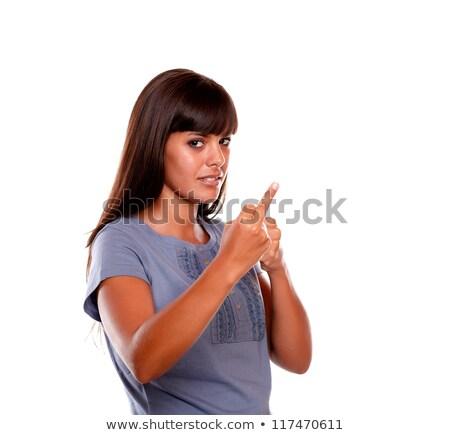 genç · kadın · parmak · yanlış · gülümseme · mavi - stok fotoğraf © pablocalvog