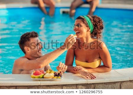 Couple poolside Stock photo © epstock