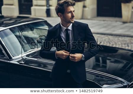 jonge · mannelijk · model · bruin · jas · grijs · gezicht - stockfoto © vanessavr