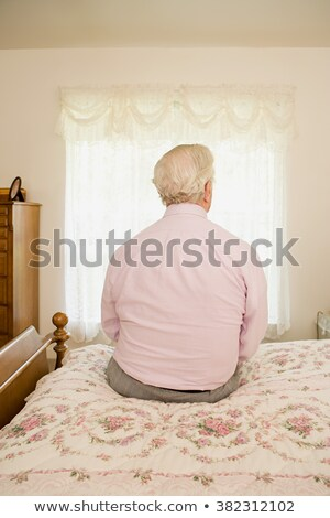 Rear view of a senior man thinking Stock photo © bmonteny