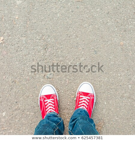 Top view of a young fashion man looking down Stock photo © feedough